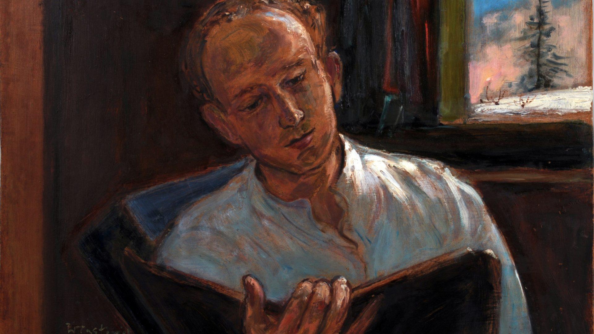 Portret siedzącego mężczyzny z czytającego książkę