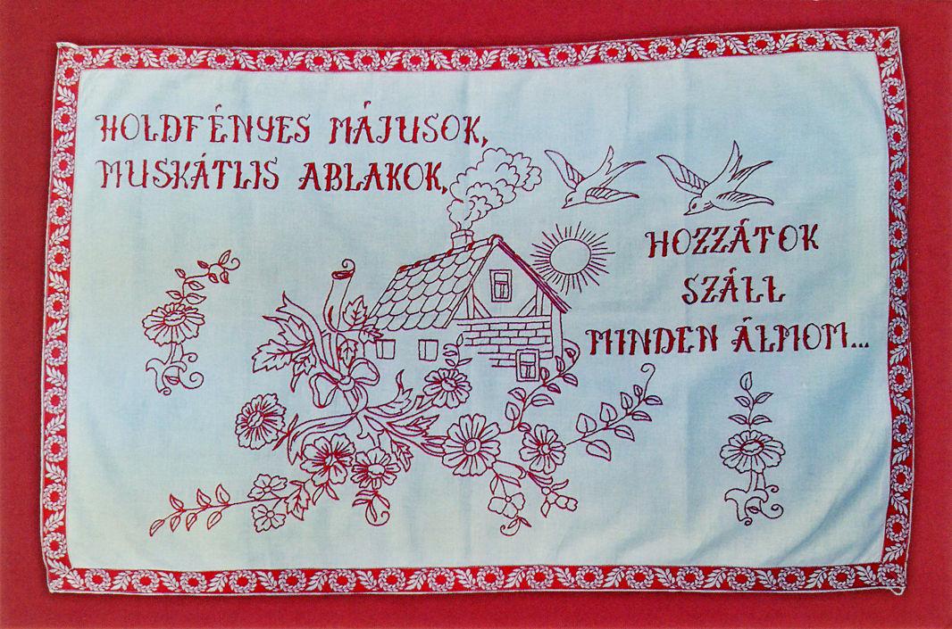 """Makatka """"Moje wszystkie sny płyną z okien pełnych pelargonii do majowego blasku księżyca ..."""" Haft czerwony, Węgry"""